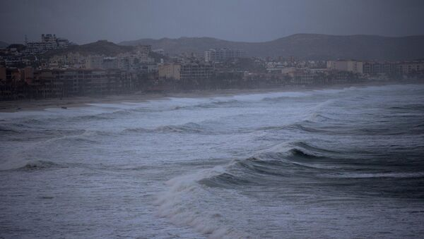Large waves and heavy clouds near as Tropical Storm Polo approaches San Jose de los Cabos, Mexico, Saturday, Sept. 20, 2014 - Sputnik International